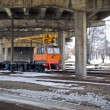 Rail car loading and transport MPT-6 goes under the bridge — Stock Photo #24008177
