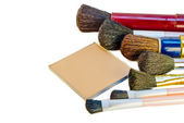 Powder and brushes — Stock Photo