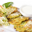 Stock Photo: Close-up of zucchini fritters with parmesan cheese and lettuce o