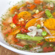 Fresh vegetable soup made of green bean, pea, carrot, potato, re — Stock Photo