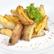 Royalty-Free Stock Photo: Fried potato with herbs on a white plate of isolation