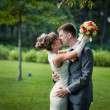 Couple kissing on the wedding day — Stock Photo