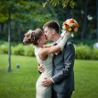 Stock Photo: Couple kissing on the wedding day