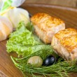 Shish kebab from a salmon with black and green olives and lemon — Stock Photo