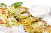 Close-up of zucchini fritters with parmesan cheese and lettuce o — Stock Photo