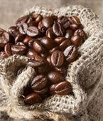 Coffee beans in burlap bag — Stock Photo