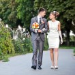 Beautiful bride and groom outdoors — Stok fotoğraf