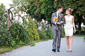 Beautiful bride and groom outdoors — Stock Photo
