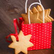 Gingerbread cookie in the shape of stars in red Christmas packag — Stock Photo #30869593