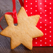 Gingerbread cookie in the shape of stars in red Christmas packet — Stock Photo