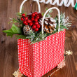 Christmas bag with decorations on a wooden table — Stock Photo #30869607