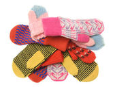 Heap of multicoloured wool mittens — Stock Photo