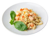 A dish of fettuccine with salmon and caviar — Stock Photo