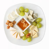 Dish of cheese with grapes — Stock Photo