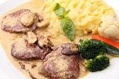 Veal in a creamy sauce with mushrooms — Stock Photo