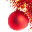 Red christmas toy with red-n-yellow tinsel — Stock Photo