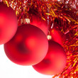 Red Christmas toys with red-n-yellow tinsel — Stockfoto