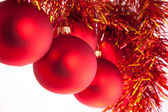 Red Christmas toys with red-n-yellow tinsel — Stock Photo