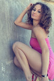 Fashionable curly brunette model posing — 图库照片