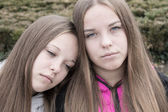 Portrait of sad twins — Stock Photo