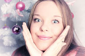 Christmas portrait of a beautiful girl — Stock Photo