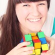 Smiling girl with  Rubiks Cube Puzzle - Stock Photo
