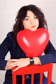 Beautiful girl with balloon in shape of heart — Stock Photo