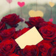 Royalty-Free Stock Photo: Red roses with a blank gift tag