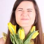 Girl with yellow tulips — Stock Photo