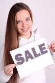Girl showing sale card — Stock Photo