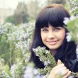 Beautiful smiling girl in the garden — Foto de Stock