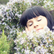 Beautiful sleeping  girl in the garden — Stock Photo