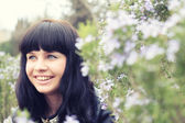 Beautiful smiling girl in the garden — Stock Photo
