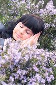 Beautiful sleeping girl in the garden — Stock Photo