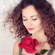 Stock Photo: Beautiful girl with big red flower