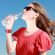 Stock Photo: Girl drinking water outdoor