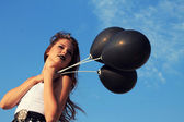Goth girl with black balloons. — Stock Photo