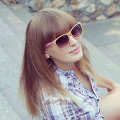 Beautiful woman with bangs. pictures in warm colors — Stock Photo