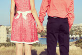 Young couple in love standing on the street in summer sunny warm weather. — Stock Photo