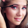 Make-up. Applying Mascara. Portrait of a young beautiful woman close-up — Stock Photo #30017889