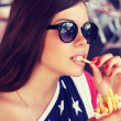 American girl eating french fries — Stock Photo #30882219