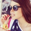 American girl eating french fries — Stock Photo