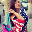 Pretty American girl in American flag t-shirt. — Zdjęcie stockowe