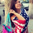 Pretty American girl in American flag t-shirt. — Foto de Stock