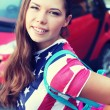 Pretty American girl in American flag t-shirt. — Stock Photo