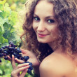 Young woman picking grapes — Stock Photo #30883571
