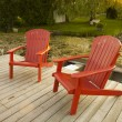 Stock Photo: Red adirondack chairs