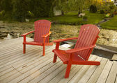 Red adirondack chairs — Stock Photo