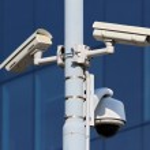 Three cctv security cameras on street pylon — Stock Photo #15482603