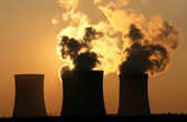 Cooling towers of nuclear power plant during sunset — Stock Photo